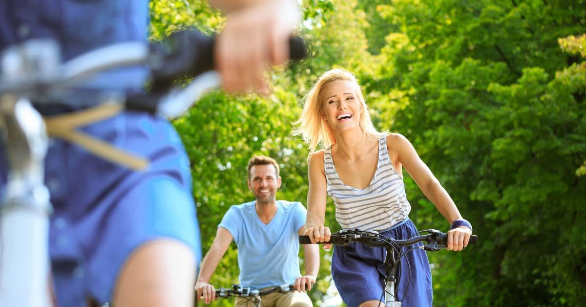 Happy woman riding bike