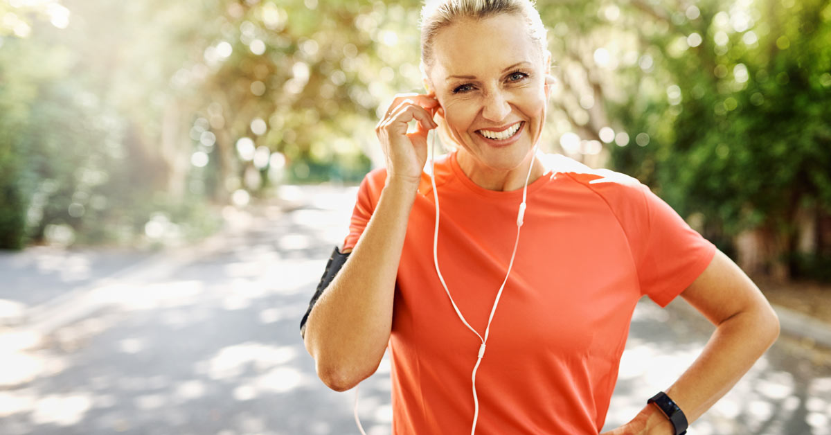 Woman outside exercising and happy.