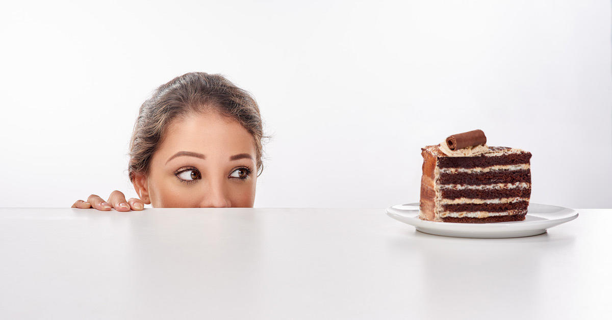 woman looking a cake