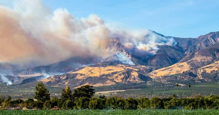 Wildfires burn in California hills