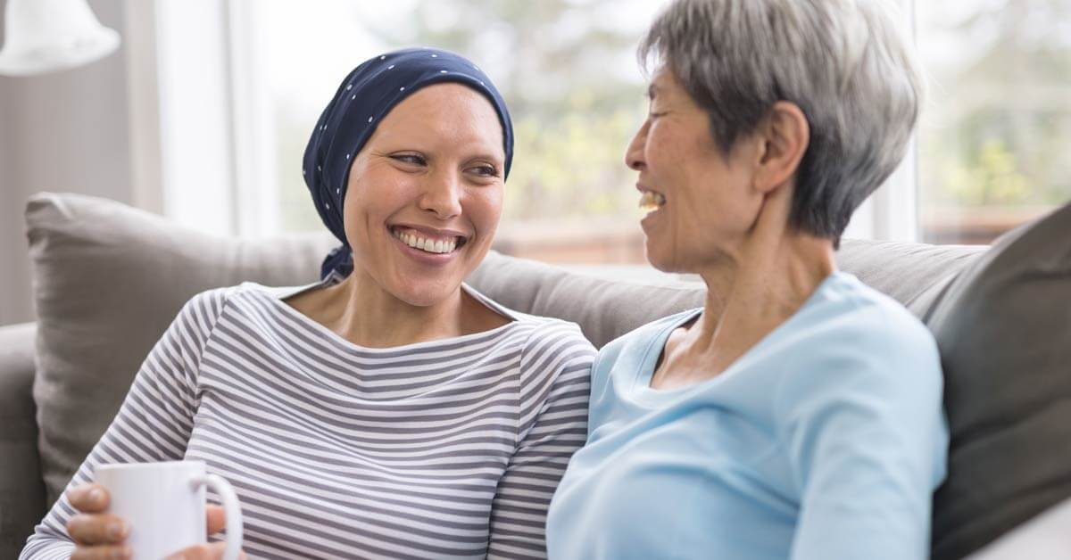 Woman with cancer talking to another woman