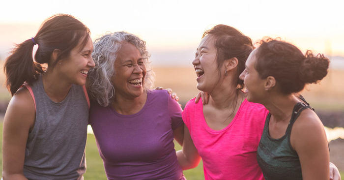Friends laughing together after a workout.