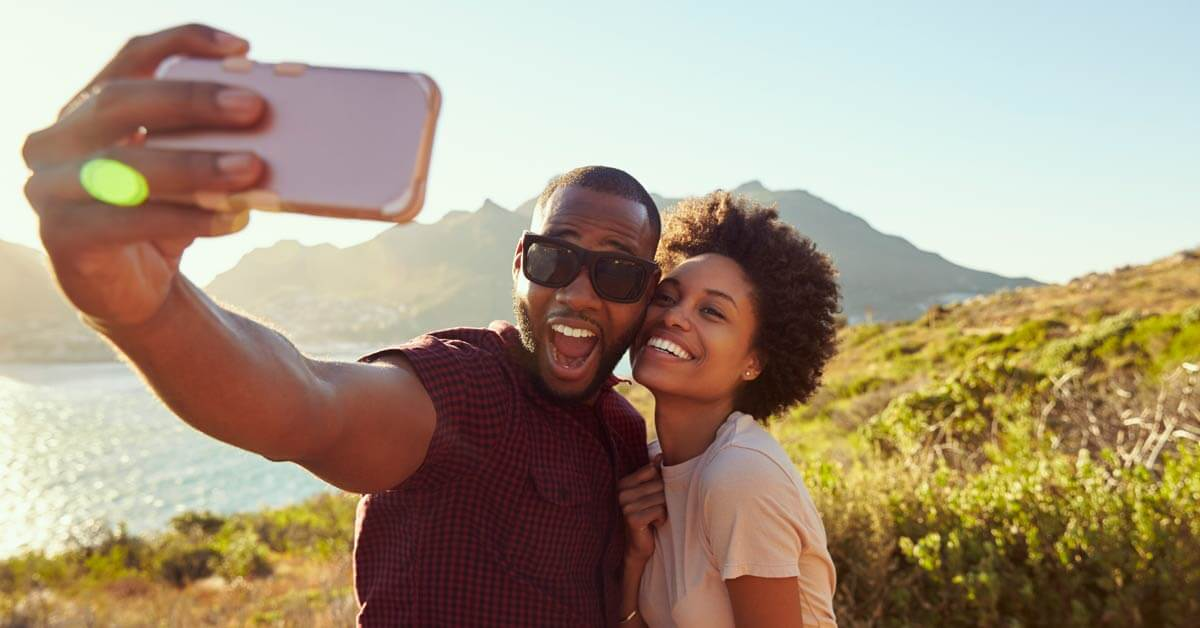Couple out and about taking selfies.